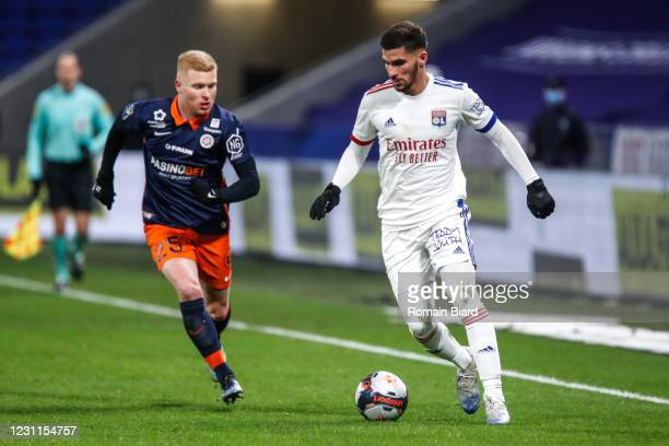 Houssem AOUAR of Lyon and Florent MOLLET of Montpellier during the Ligue 1 match between Olympique Lyon and Montpellier HSC at Groupama Stadium on...