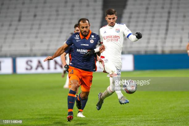 Houssem AOUAR of Lyon and HILTON of Montpellier during the Ligue 1 match between Olympique Lyon and Montpellier HSC at Groupama Stadium on February...