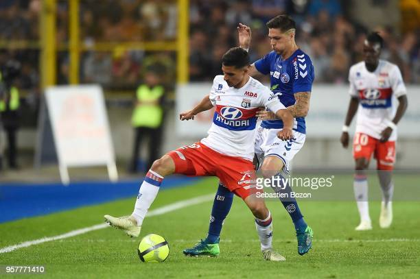 Houssem Aouar of Lyon and Jonas Martin of Strasbourg during the Ligue 1 match between Strasbourg and Lyon at Stade de la Meinau on May 12 2018 in...