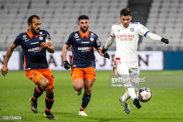 Houssem AOUAR of Lyon and Jordan FERRI of Montpellier and HILTON of Montpellier during the Ligue 1 match between Olympique Lyon and Montpellier HSC...