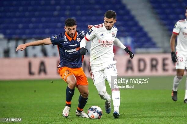 Houssem AOUAR of Lyon and Jordan FERRI of Montpellier during the Ligue 1 match between Olympique Lyon and Montpellier HSC at Groupama Stadium on...