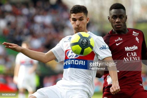 Houssem Aouar of Lyon and Moussa Niakhate of Metz during the Ligue 1 match between Metz and Olympique Lyonnais at on April 8 2018 in Metz