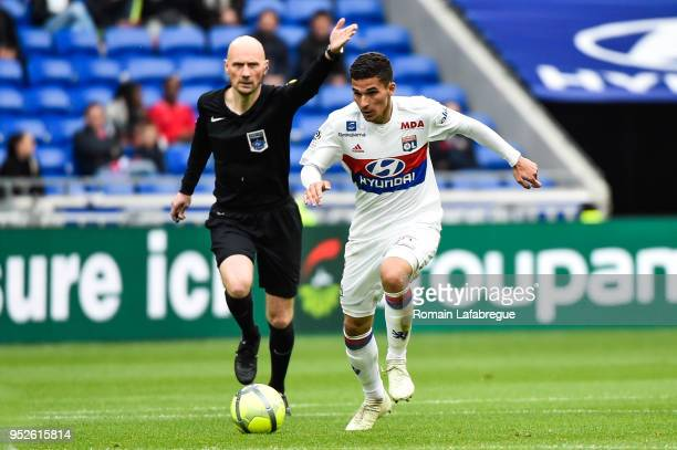 Houssem Aouar of Lyon and the referee Antony Gautier during the Ligue 1 match between Olympique Lyonnais and Nantes at Parc Olympique on April 28...