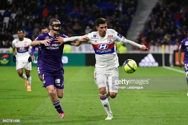 Houssem Aouar of Lyon and Yannick Cahuzac of Toulouse during the Ligue 1 match between Olympique Lyonnais and Toulouse FC on April 1 2018 in Lyon...