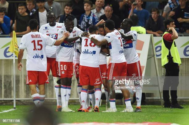 Houssem Aouar of Lyon celebrates scoring with teammates during the Ligue 1 match between Strasbourg and Lyon at Stade de la Meinau on May 12 2018 in...