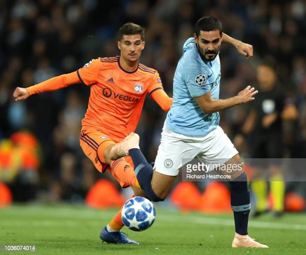 Houssem Aouar of Lyon is challenged by Ilkay Gundogan of Manchester City during the Group F match of the UEFA Champions League between Manchester...