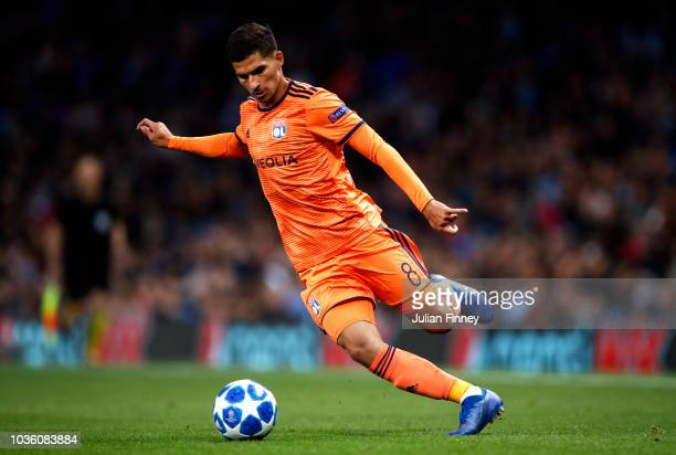 Houssem Aouar of Lyon runs with the ball during the Group F match of the UEFA Champions League between Manchester City and Olympique Lyonnais at...