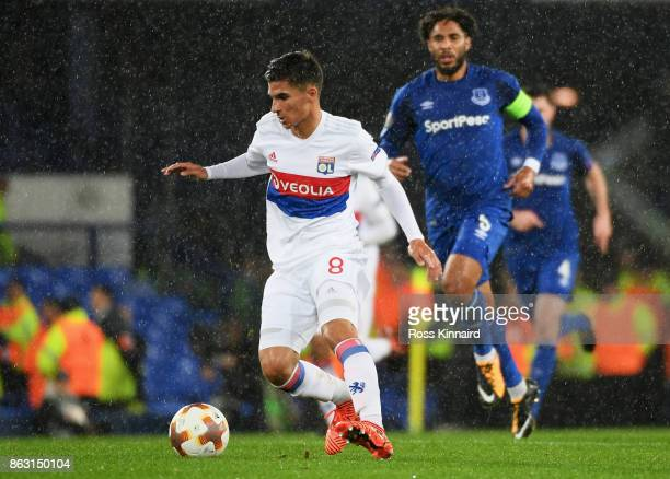 Houssem Aouar of Lyon runs with the ball during the UEFA Europa League Group E match between Everton FC and Olympique Lyon at Goodison Park on...