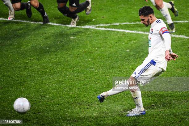 Houssem AOUAR of Lyon scores the penalty during the french cup match between Lyon and Ajaccio at Groupama Stadium on February 9, 2021 in Lyon, France.