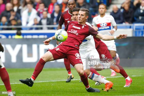 Houssem Aouar of OL and Chris Philipps of Metz during the Ligue 1 match between Olympique Lyonnais and Fc Metz at Parc Olympique on October 29 2017...