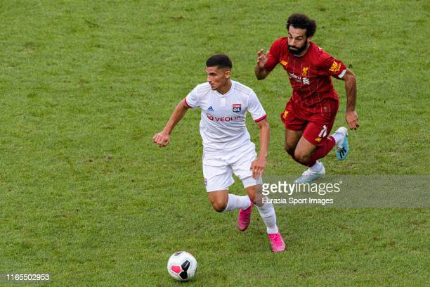 Houssem Aouar of Olympique Lyon in action against Mohamed Salah of Liverpool during the PreSeason Friendly match between Liverpool FC and Olympique...