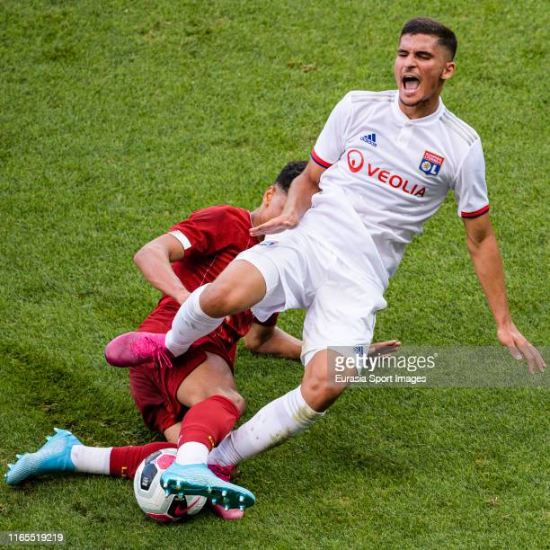 Houssem Aouar of Olympique Lyon is challenged by Ki Jana Hoever of Liverpool during the PreSeason Friendly match between Liverpool FC and Olympique...
