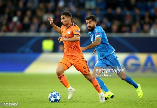 Houssem Aouar of Olympique Lyonnais breaks away from Kerem Demirbay of 1899 Hoffenheim during the Group F match of the UEFA Champions League between...