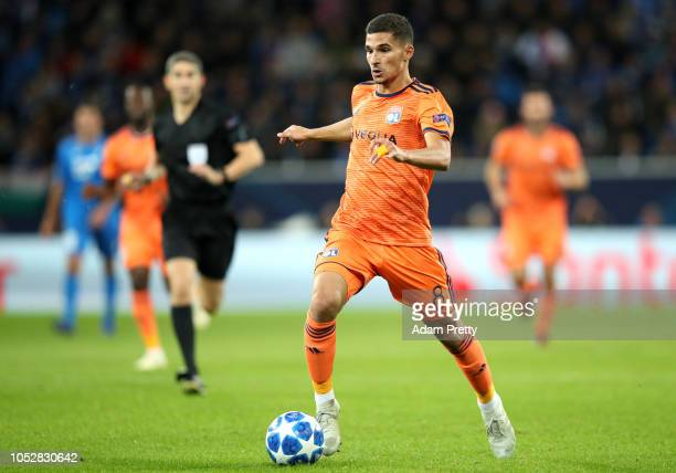 Houssem Aouar of Olympique Lyonnais runs with the ball during the Group F match of the UEFA Champions League between TSG 1899 Hoffenheim and...