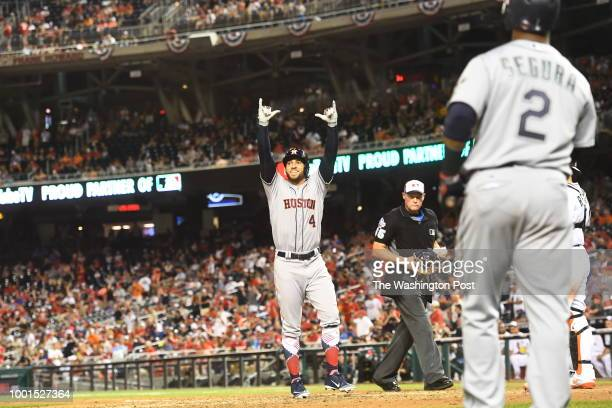C JULY Houston Astros and the American League outfielder George Springer celebrates after he crosses home plate after scoring in the tenth inning...