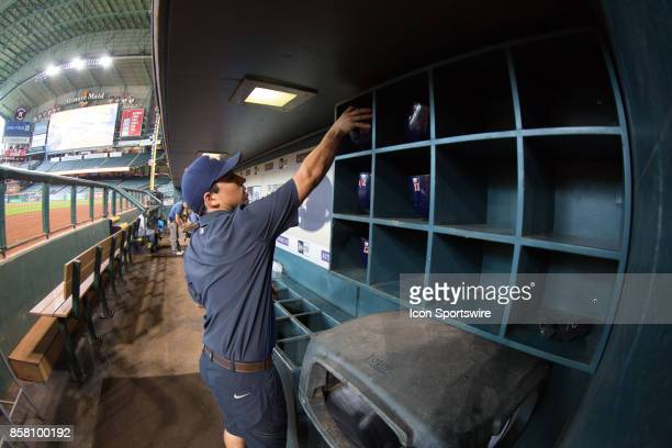 Houston Astros ball boy set the batting helmets in the rack prior to an MLB game between the Houston Astros and the Los Angeles Angels at Minute Maid...