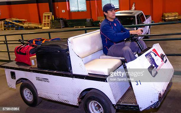 Houston Astros bullpen catcher Carlos Munoz loading the truck with players belongings to be shipped to Kissimmee FL for Astros spring training during...