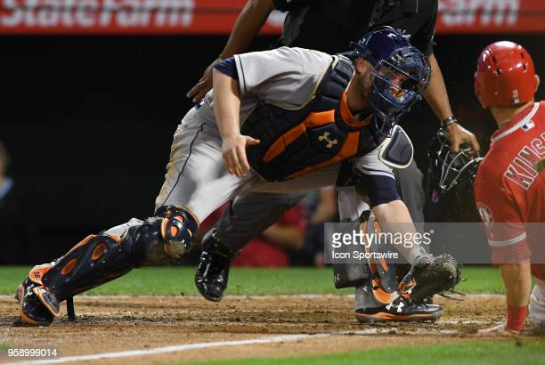Houston Astros catcher Brain McCann gets ready to tag Los Angeles Angels of Anaheim second baseman Ian Kinsler out at the plate in the seventh inning...