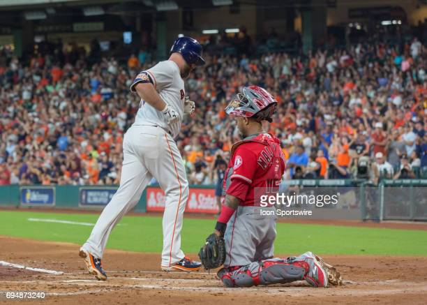 Houston Astros catcher Brian McCann taps home plate after hitting a homer in the second inning of the MLB game between the Los Angeles Angels and...