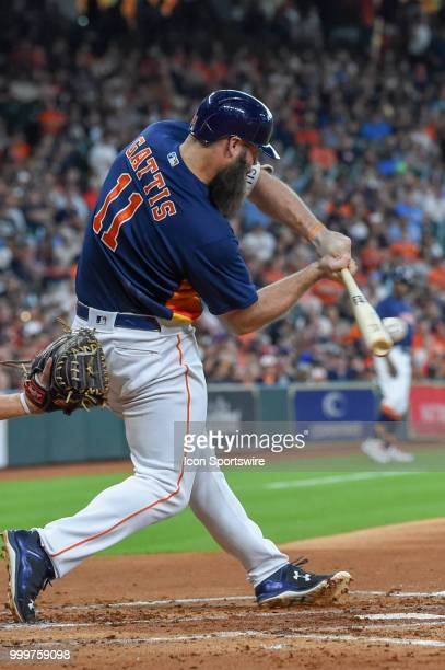 Houston Astros catcher Evan Gattis makes solid contact during the baseball game between the Detroit Tigers and the Houston Astros on July 15 2018 at...
