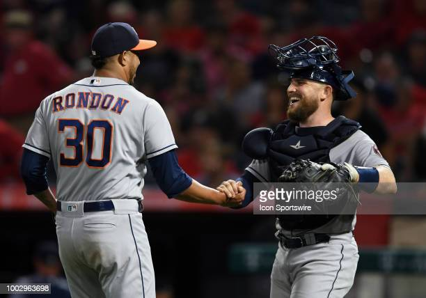 Houston Astros catcher Evan Stassi celebrates with pitcher Héctor Rondón after the Astros defeated the Los Angeles Angels of Anaheim 3 to 1 in a game...