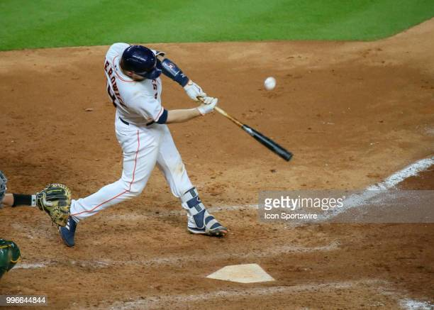 Houston Astros catcher Tim Federowicz hits a foul ball in the bottom of the eighth inning during the baseball game between the Oakland Athletics and...