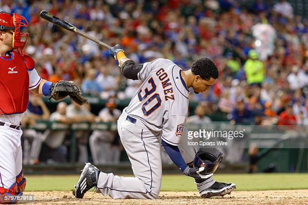 Houston Astros Center field Carlos Gomez [6287] catches his helmet midswing during the MLB game between the Houston Astros and the Texas Rangers...