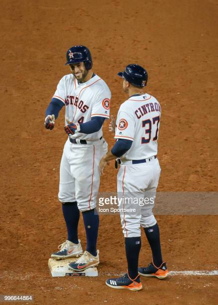 Houston Astros center fielder George Springer gets on first base in the bottom of the ninth inning during the baseball game between the Oakland...