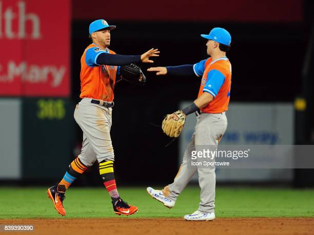 Houston Astros center fielder George Springer is greeted by shortstop Alex Bregman on the field after the Astros defeated the Los Angeles Angels of...