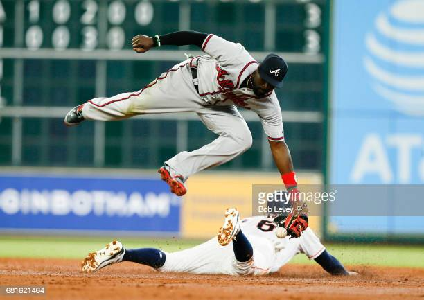 Houston Astros center fielder Jake Marisnick steals second base in the third inning as Atlanta Braves second baseman Brandon Phillips can't handle...