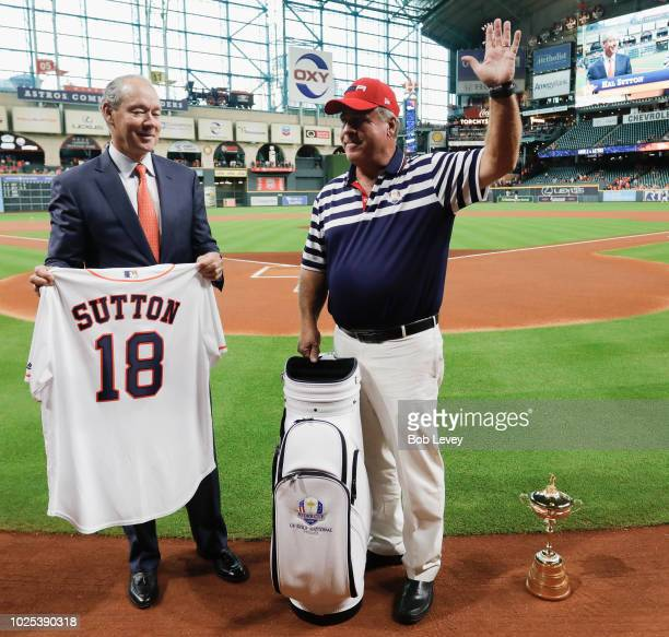 Houston Astros CEO and owner Jim Crane left and former Ryder Cup captain Hal Sutton exchange gifts as part of the Ryder Cup Trophy Tour at Minute...