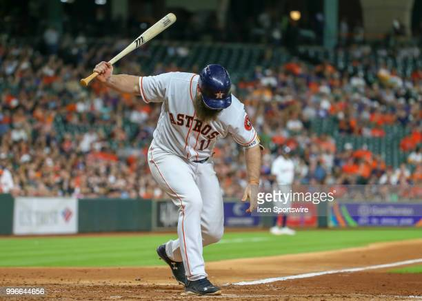 Houston Astros designated hitter Evan Gattis moves to avoid being hit by a pitch in the bottom of the fifth inning during the baseball game between...