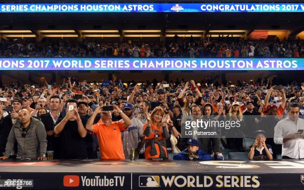 Houston Astros fans cheer after the final out of Game 7 of the 2017 World Series against the Los Angeles Dodgers at Dodger Stadium on Wednesday...