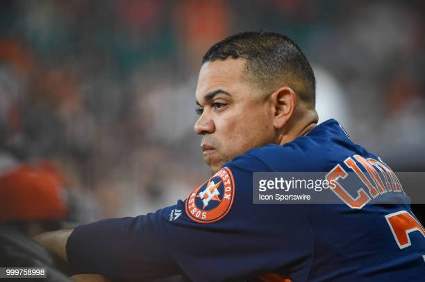 Houston Astros first base coach Alex Cintron looks on from the dugout during the baseball game between the Detroit Tigers and the Houston Astros on...