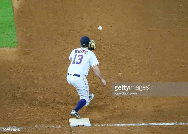 Houston Astros first baseman Tyler White gets an out on Oakland Athletics shortstop Marcus Semien in the top of the ninth inning during the baseball...