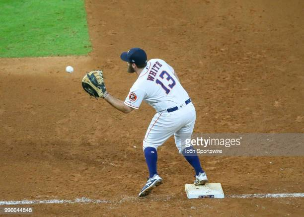 Houston Astros first baseman Tyler White gets an out on Oakland Athletics catcher Jonathan Lucroy in the top of the ninth inning during the baseball...