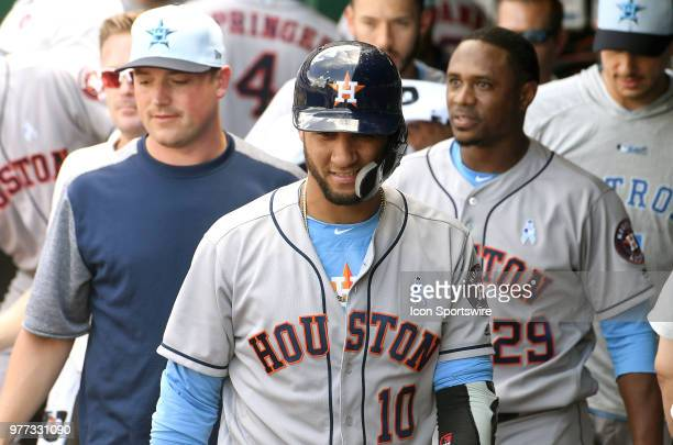 Houston Astros first baseman Yuli Gurriel smiles in the dugout after scoring the winning run in the eighth inning during a Major League Baseball game...