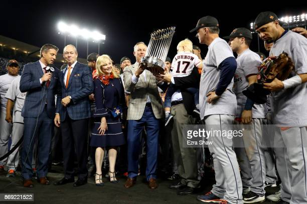 Houston Astros general manager Jeff Luhnow holds the Commissioner's Trophy after defeating the Los Angeles Dodgers 51 in game seven to win the 2017...
