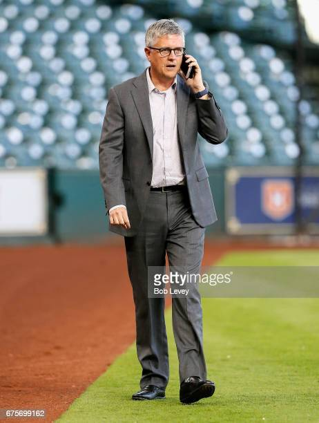 Houston Astros general manager Jeff Luhnow talks on the phone before a game against the Texas Rangers at Minute Maid Park on May 1 2017 in Houston...