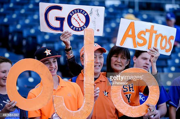 Houston Astros hold up signs before Game 5 of the ALDS against the Kansas City Royals at Kauffman Stadium on Wednesday October 14 2015 in Kansas City...