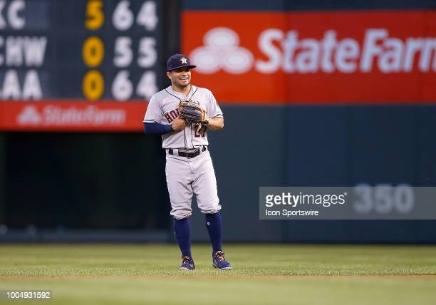 Houston Astros infielder Jose Altuve waits for a pitch during a regular season interleague MLB game between the Colorado Rockies and the visiting...