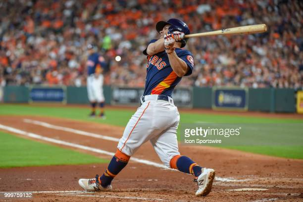 Houston Astros infielder Jose Altuve watches a hit on his follow through during the baseball game between the Detroit Tigers and the Houston Astros...