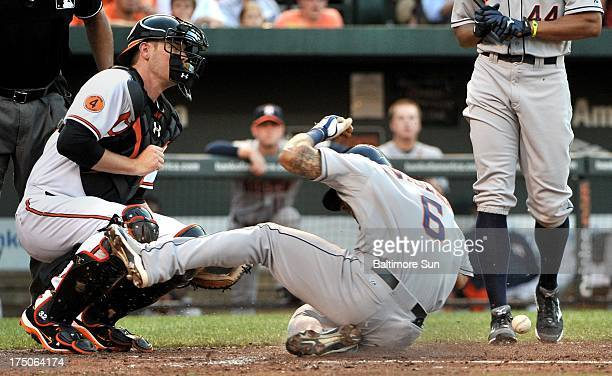Houston Astros' Jonathan Villar steals home in the top of the third inning past Baltimore Orioles catcher Matt Wieters at Oriole Park at Camden Yards...