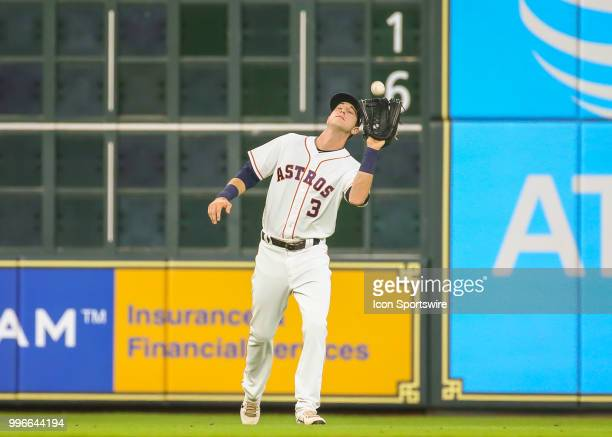 Houston Astros left fielder Kyle Tucker catches a pop fly in the top of the first inning during the baseball game between the Oakland Athletics and...