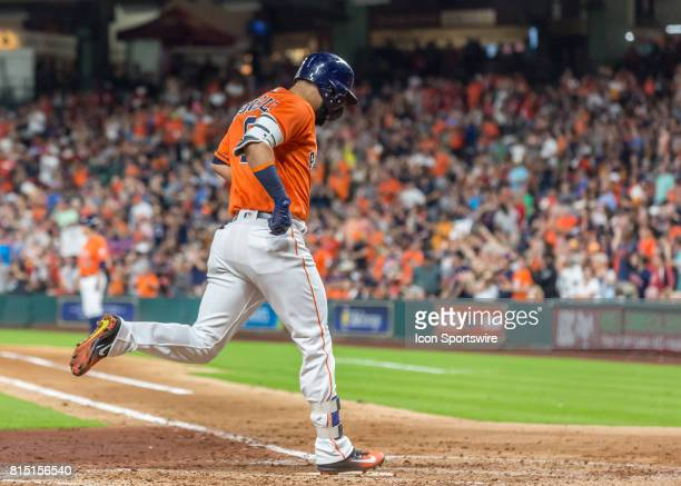 Houston Astros left fielder Marwin Gonzalez taps home plate after scoring a run in the second inning of the MLB game between the Minnesota Twins and...