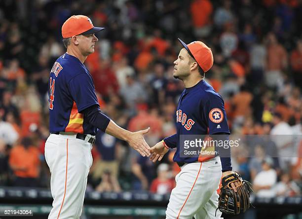 Houston Astros manager AJ Hinch greets Jose Altuve after the Astros beat the Detroit Tigers 54 at Minute Maid Park on April 17 2016 in Houston Texas