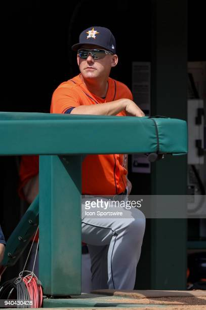 Houston Astros Manager AJ Hinch looks on from the dugout during the baseball game between the Houston Astros and Texas Rangers on March 31 2018 at...