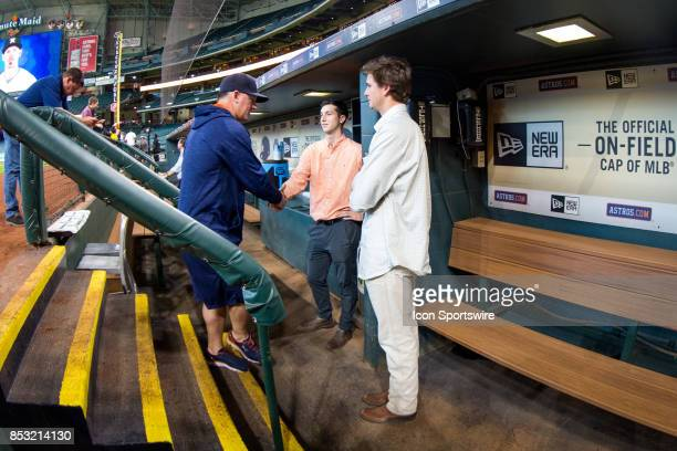 Houston Astros manager AJ Hinch shakes hands with minor league players OF Kyle Tucker and RHP Forrest Whitley looks on prior to an MLB game between...