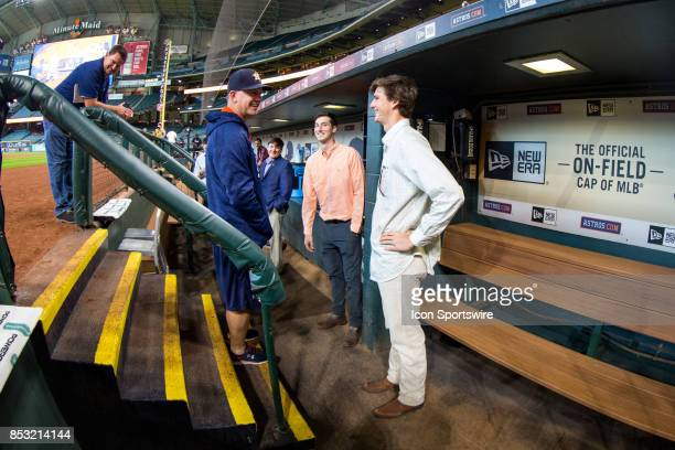 Houston Astros manager AJ Hinch talking to minor league players OF Kyle Tucker and RHP Forrest Whitley prior to an MLB game between the Houston...