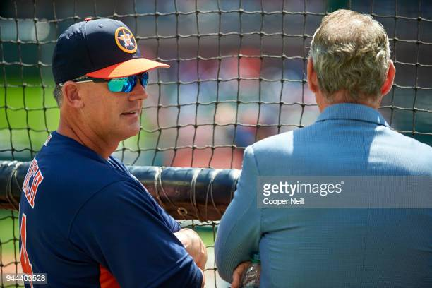 Houston Astros manager AJ Hinch visits with team owner Jim Crane before the first pitch against the Texas Rangers at Globe Life Park on Thursday...